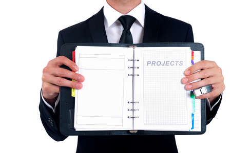 Isolated business man showing agenda page photo