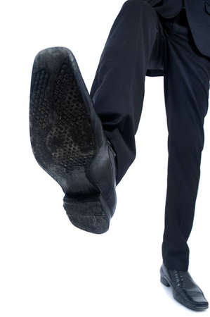 Business man foot trample closeup photo