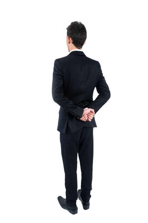 Isolated young business man standing photo
