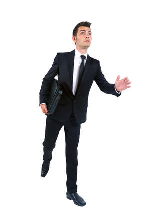 Isolated young business man running with notebook photo