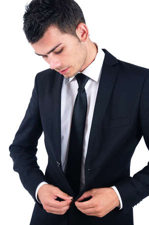 Isolated young business man arranging suit photo