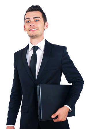 Isolated business man standing with laptop photo