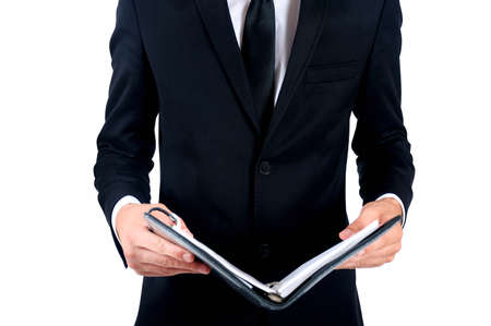 Isolated business man standing with notebook