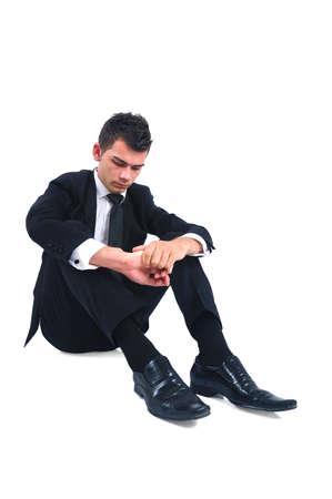 Isolated sad business man sitting down  photo