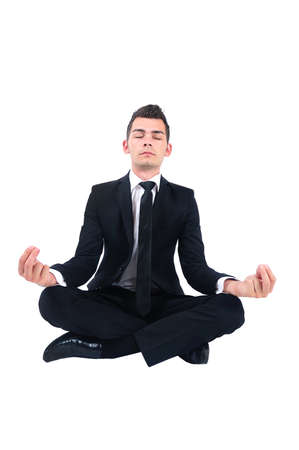 Isolated business man doing yoga photo