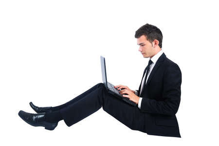 lying on side: Business man at notebook Stock Photo