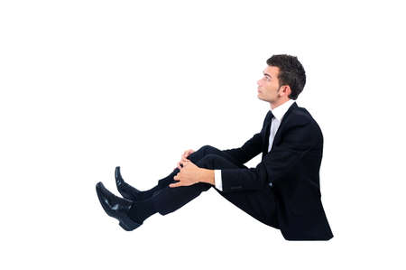 Isolated business man sitting down and looking up photo