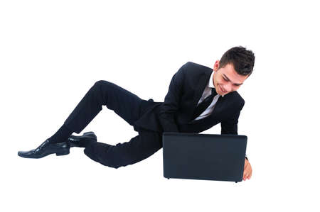 Isolated business man smiling at laptop photo