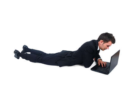 Isolated business man laying with notebook photo