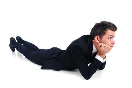 Hombre de negocios aislado pensando en blanco Foto de archivo
