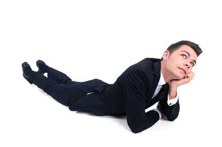 naar beneden kijken: Geïsoleerde zakenman denken op witte