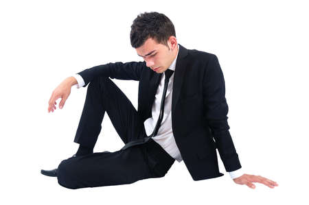 Isolated sad business man sitting Stock Photo