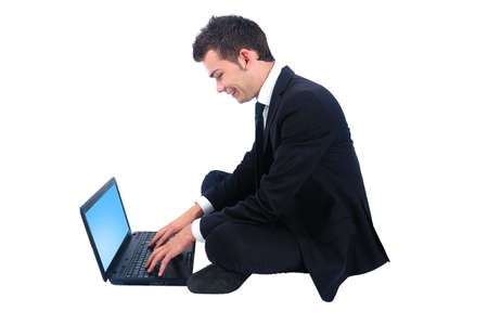 Isolated happy business man with notebook photo