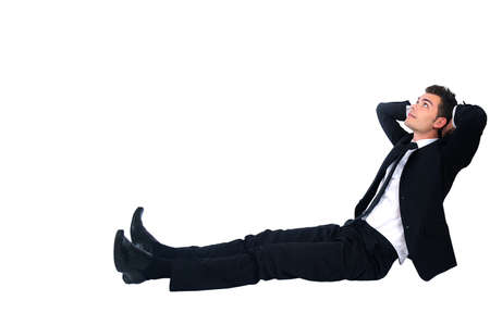 Isolated business man relaxing on white photo