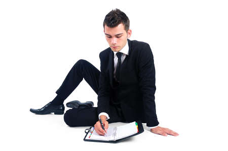 Isolated business man with agenda photo