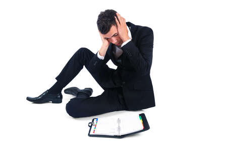 Isolated business man stressed with agenda Stock Photo - 14745885