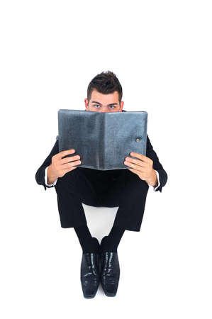 Isolated business man with agenda Stock Photo - 14745636