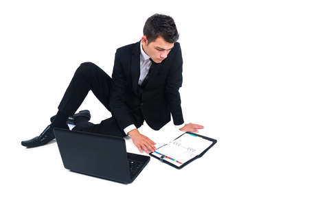 Isolated business man with agenda and laptop photo