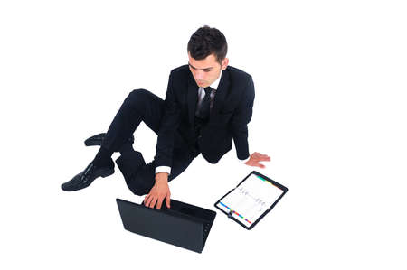 Isolated business man with agenda and laptop Stock Photo - 14745899