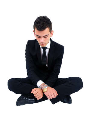 Isolated business man locked with chain photo