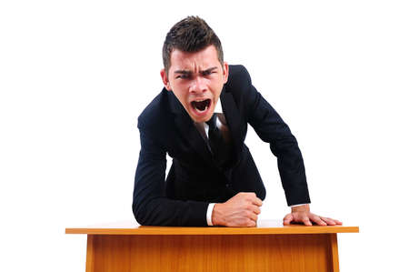 angry boss: Isolated business man screaming at desk