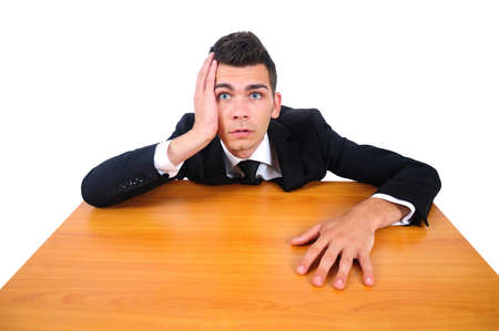 Isolated business man tired at desk