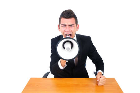 Isolated business man screaming with loudspeaker photo