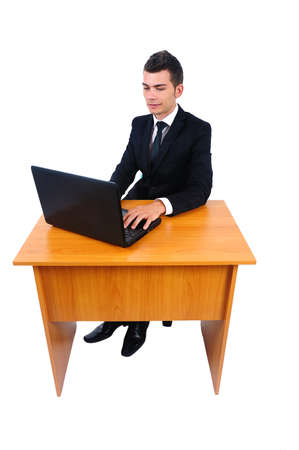 Isolated business man with laptop at desk  photo