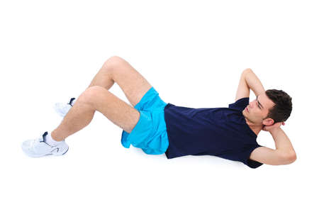 Isolated man in sport wear abs exercise Stock Photo
