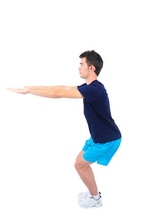 Isolated man in sport wear preparing squats