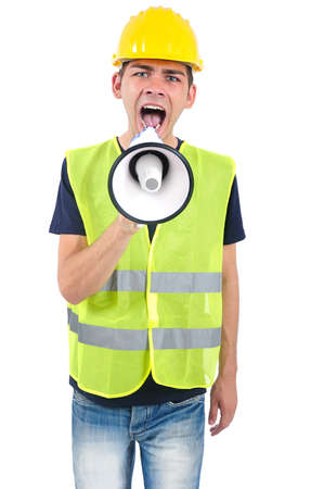 Isolated worker with helmet screaming with loudspeaker photo