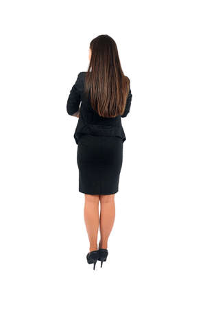 Isolated young business woman back view photo
