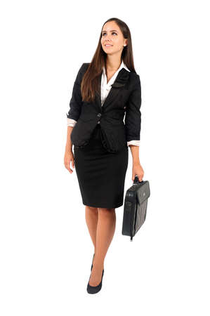 full suit: Isolated young business woman walking