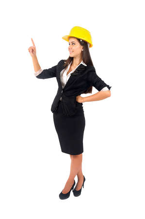 Isolated young worker girl with helmet Stock Photo - 15387933