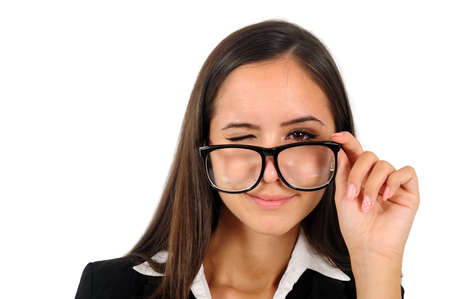 Isolated young business woman blinkeye with eyeglasses photo