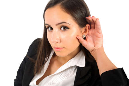 Isolated young business woman eavesdrop at camera photo