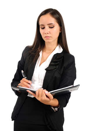 Isolated young business woman writing photo