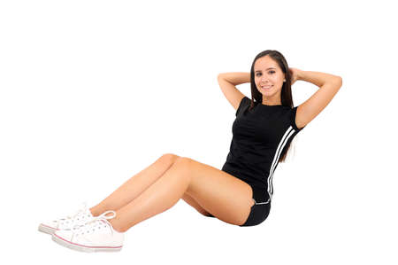 laying abs exercise: Isolated brown hair fitness woman