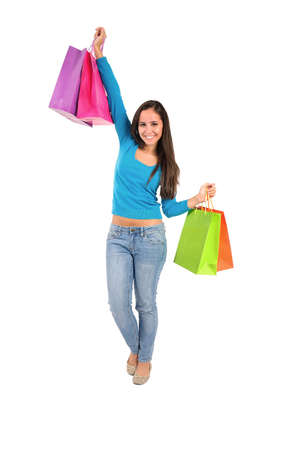 Isolated casual young woman with shopping bag happy photo