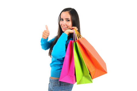 Isolated young casual girl with shopping bag approve photo