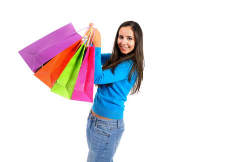 Isolated young casual girl with shopping bag photo