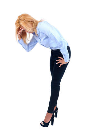 bending down: Isolated young business woman looking down