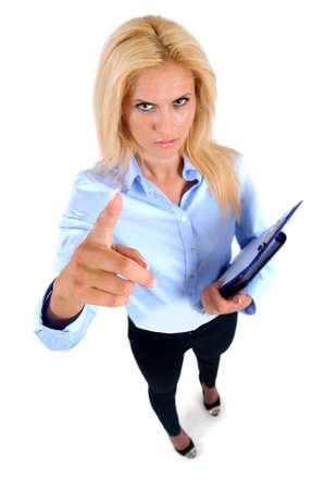 angry boss: Isolated young business woman pointing
