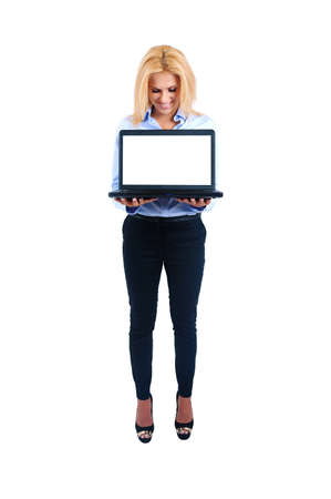 Isolated young business woman holding laptop photo