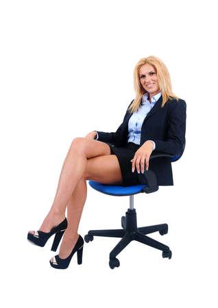 Isolierte junge Business-Frau sitzt Standard-Bild