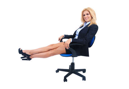 Isolated young business woman sitting photo