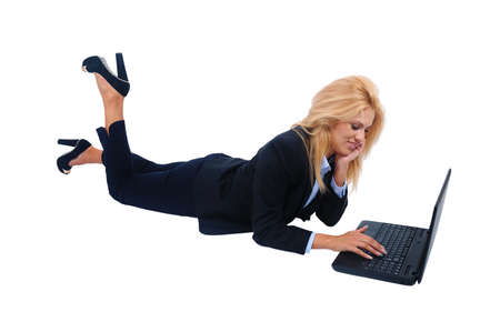 Isolated young business woman using laptop photo