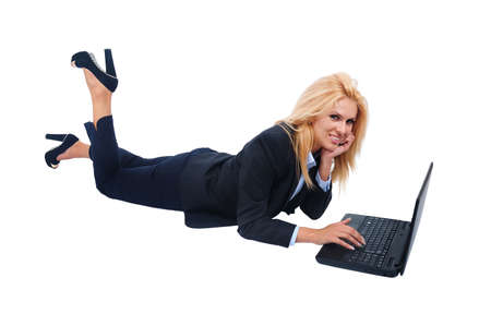 Isolated young business woman using laptop Stock Photo