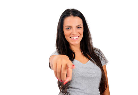 Isolated young casual woman pointing camera photo