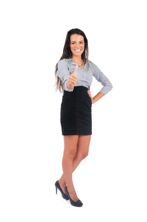Isolated young business woman ok sign photo